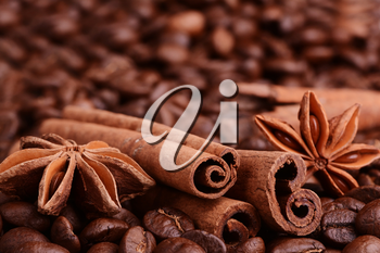 coffee beans, cinnamon, star anise on sacking background.