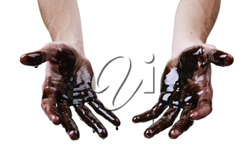 Caucasian hands cupped with black heavy fuel isolated on white background