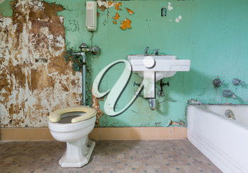 Old bathroom and toilet needs some renovation work inside Trans-Allegheny Lunatic Asylum in Weston, West Virginia, USA