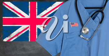 Blue doctor scrubs shirt and stethoscope hang empty in front of British flag. Illustration of medical staff coming from USA or America to staff national health service