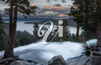 Sunset at Emerald Bay on Lake Tahoe from the top of Lower Eagle Falls as the torrent of water from snow melt flows into the lake from Sierra Nevada Mountains.