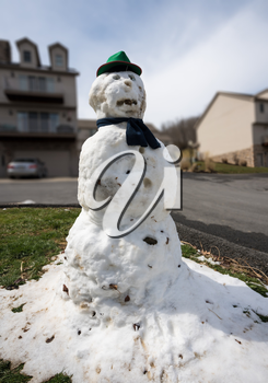 Funny snowman is all that remains of snow storm in spring