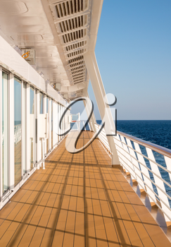 Walkway around the deck of a modern luxury cruise ship at sea