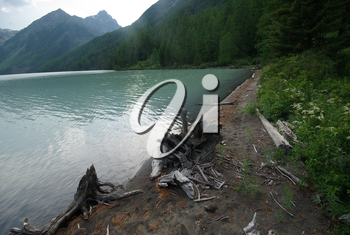 Beautiful mountain landscape near the lake. Mountain Lake. Kind of mountainous terrain and the water in the valley.