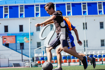 Football game. Training matches junior teams and fans.