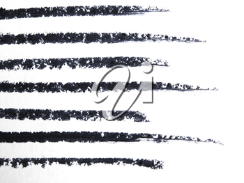 close up of a eyeliner pencil drawing on white background