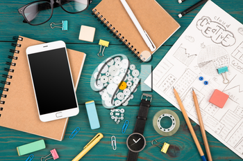 Idea concept - phone, watch, notepads, pencils and colorful office supplies