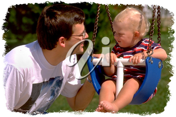 Royalty Free Photo of an Infant Child in a Baby Swing Observing Daddy Beside Him