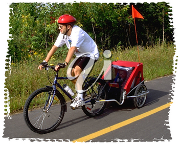 Royalty Free Photo of a Man on a Bike Pulling a Caboose with Child
