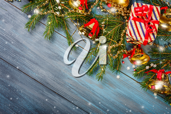 Christmas  decorations on a blue wooden background, with space for text