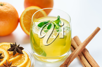Juice from fresh oranges and spices on a white background