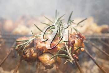 Grilled Deboned Chicken Meat On Smoking Barbecue With Rosemary