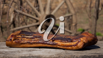 Whole Smoked Bacon Slab Resting On A Rustic Wooden Surface. Delicious Domestic Food