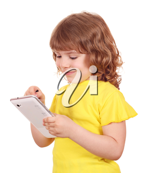 happy little girl playing with tablet