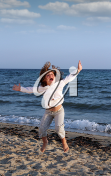 happy child jumping on beach