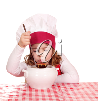 little girl cook taste soup