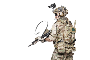 Elite member of US Army rangers in combat uniforms with his shirt sleeves rolled up, in helmet, eyewear and night vision goggles. Studio shot, white background