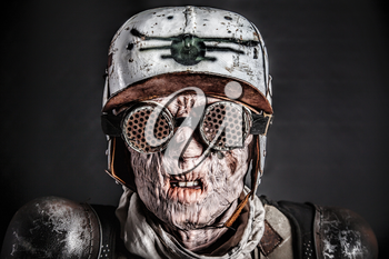 Post apocalyptic survivor masked ugly face. Skin burned by atomic flame