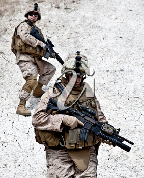 Two soldiers in the mountains during the military operation