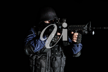 Special weapons and tactics (SWAT) team officer on black background