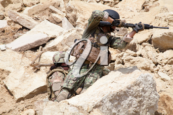 Members of Navy SEAL Team with weapons in action