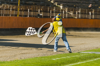 lLviv, Ukraine - 17 April 2016:  Man with a checkered flag indicates the finish at the  Flat Track  National Championship  to the Lviv city