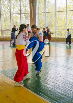 Lviv, Ukraine - April 25.2015: Competitors in the martial arts to perform in the gym in the city park in Lviv, Ukraine
