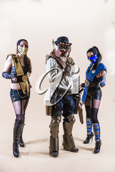 Lviv, Ukraine - May 23.2015:Cosplayer boy and girls posing in a steampunk suit and a respirator mask , Photo taken at cosplayers meeting indoor concert hall in Lviv city.May 23.2015