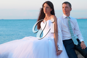 Beautiful wedding couple- bride and groom at the beach. Just married