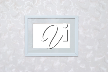 Empty blank white isolated photo frame on wall