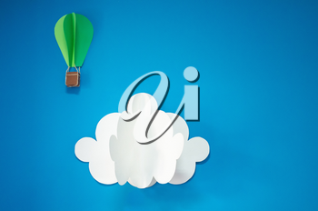 Handmade hot air balloon and cloud in the sky. Paper art style. Isolates on blue background. Blank for motivating quote, note, message and comment. Idea for poster, banner, flyer.