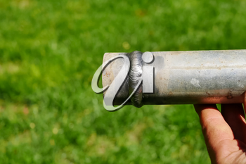 Metal pipe with a welded seam In the hand of a welder's man