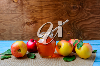 Healthy eating concept with glass honey jar and fresh apples, copy space. Jewesh new year symbols.
