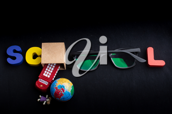 Education concept by School lettering  with colorful wooden letters