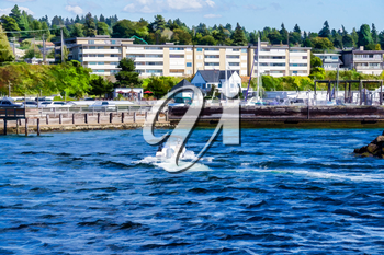 A boat enters port in Des Moinese, Washington.