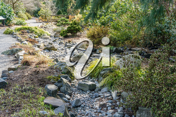 A view of a dry rocky creek bed in Seatac, Washington.