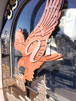 Brass copper color American eagle bird emblem on USS Iowa naval warship destroyer battleship