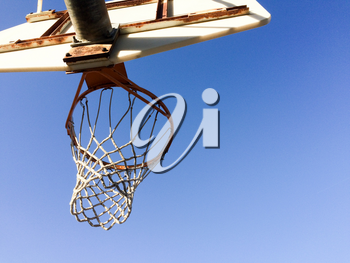 Basketball hoop with net outdoor court blue sky sunny play day