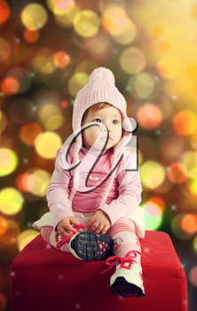 Cute baby with winter clothing in Christmas theme