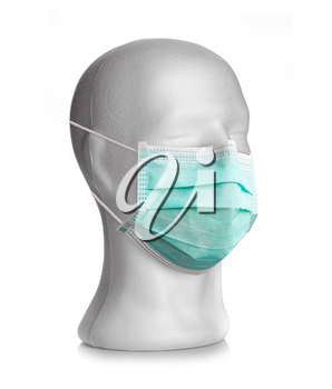 Dummy Head with Surgical Mask on White Background. Coronavirus covid-19.