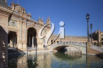 The Plaza de Espana Spain Square is a plaza in the Parque de Mara Luisa, in Seville, Spain built in 1928 for the Ibero-American Exposition of 1929
