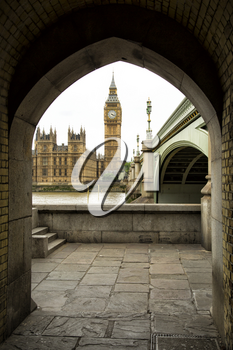 Westminster parliament through an arch in London, UK