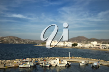 Fishing boats at the marina with tilt shift effect in Paros, Greece